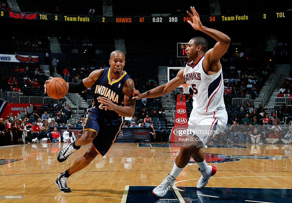 David West #21 of the Indiana Pacers drives against Al Horford #15 of the Atlanta Hawks at Philips Arena on October 22, 2013 in Atlanta, Georgia.