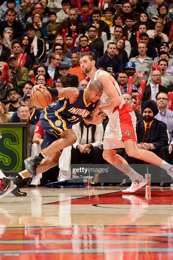 David West #21 of the Indiana Pacers drives against Andrea Bargnani #7 of the Toronto Raptors on March 1, 2013 at the Air Canada Centre in Toronto, Ontario, Canada.