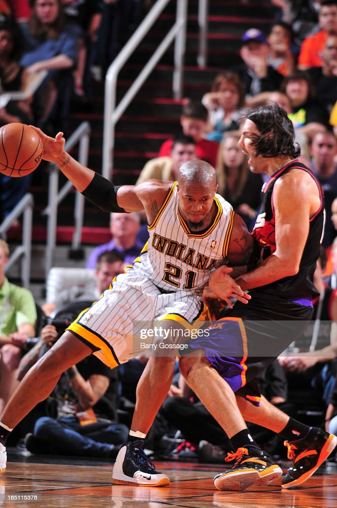 David West #21 of the Indiana Pacers drives against Luis Scola #14 of the Phoenix Suns on March 30, 2013 at U.S. Airways Center in Phoenix, Arizona.