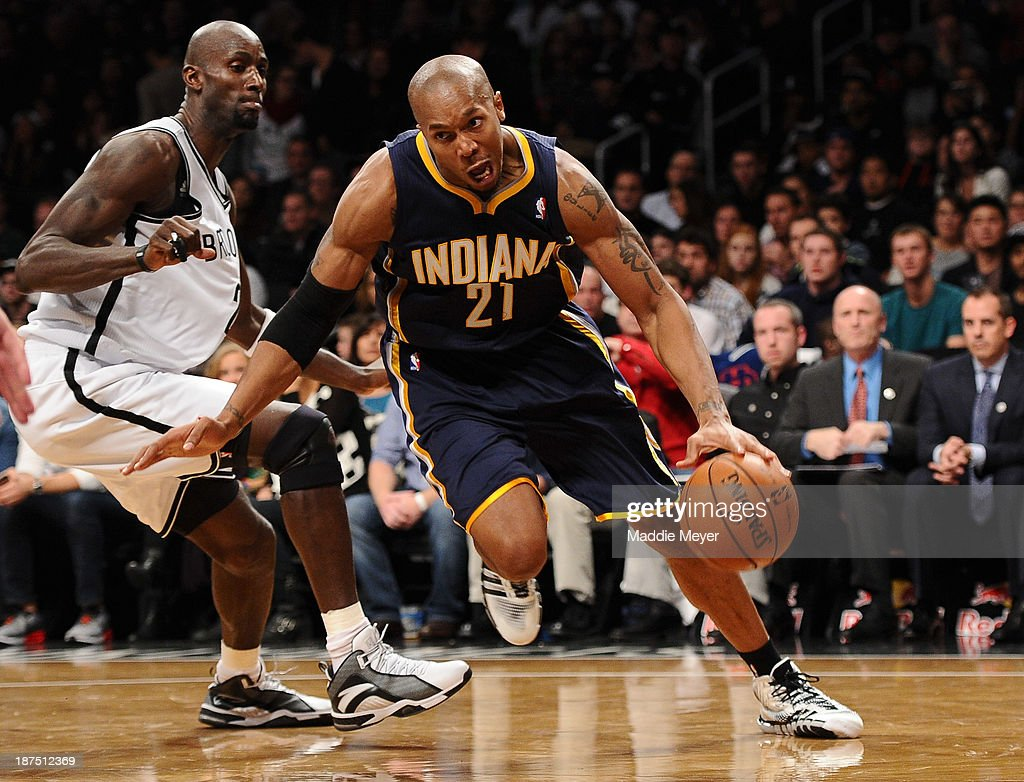 David West #21 of the Indiana Pacers drives past Kevin Garnett #2 of the Brooklyn Nets during the second half at Barclays Center on November 9, 2013 in the Brooklyn borough of New York City. The Pacers defeat the Nets 96-91.