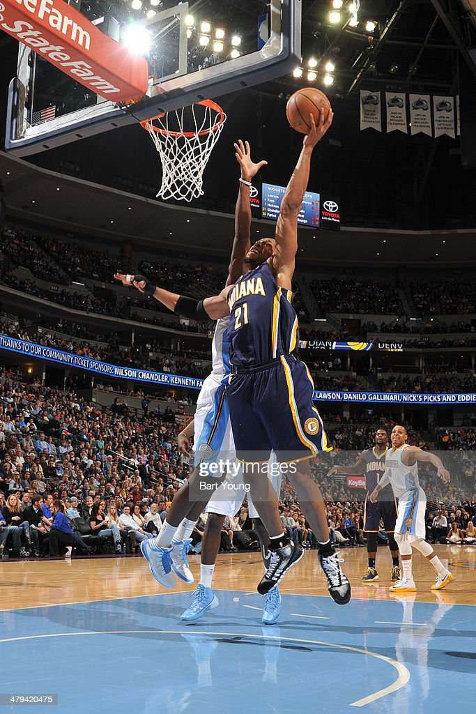 David West #21 of the Indiana Pacers drives to the basket against the Denver Nuggets on January 25, 2014 at the Pepsi Center in Denver, Colorado.