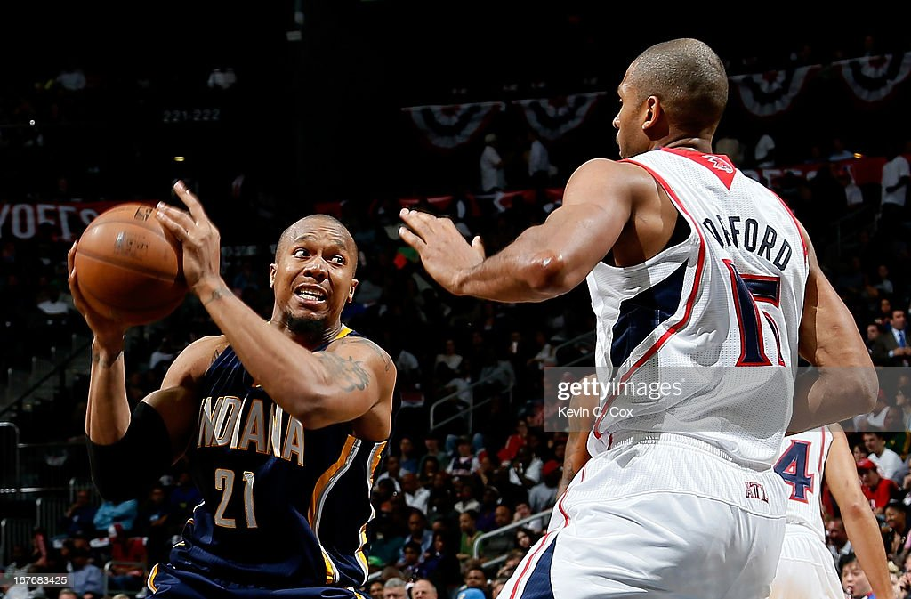 David West #21 of the Indiana Pacers drives toward Al Horford #15 of the Atlanta Hawks during Game Three of the Eastern Conference Quarterfinals of the 2013 NBA Playoffs at Philips Arena on April 27, 2013 in Atlanta, Georgia.