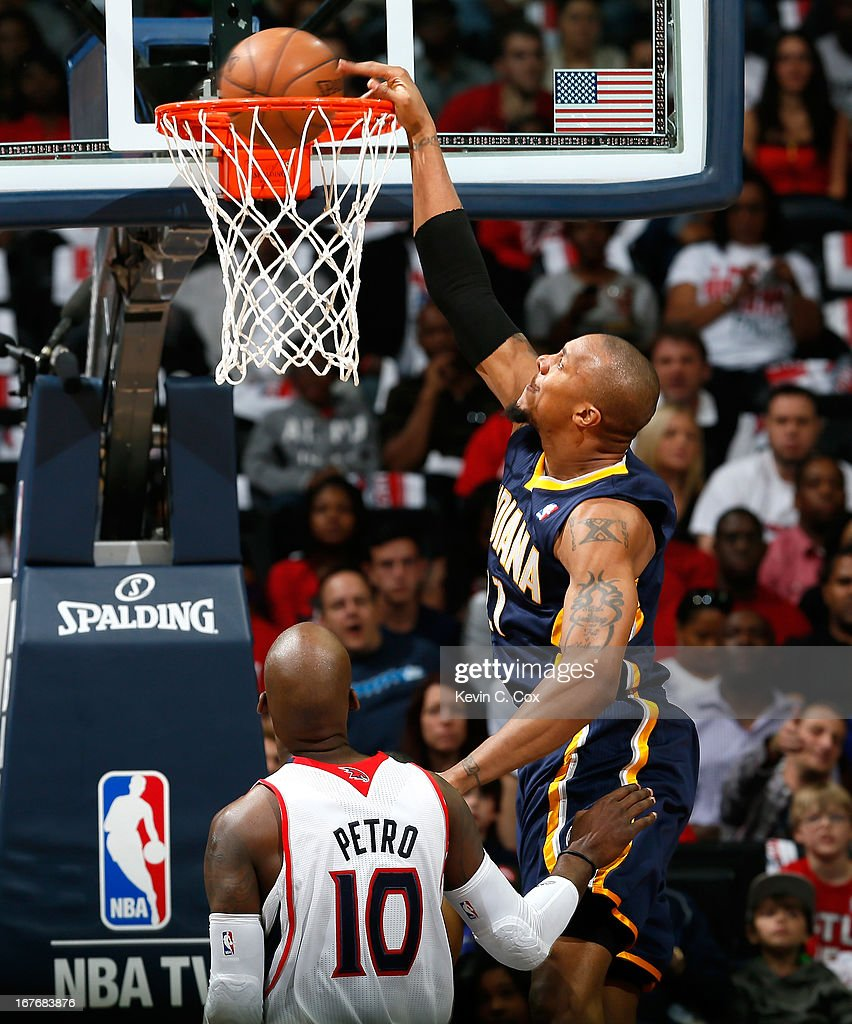 David West #21 of the Indiana Pacers dunks against Johan Petro #10 of the Atlanta Hawks during Game Three of the Eastern Conference Quarterfinals of the 2013 NBA Playoffs at Philips Arena on April 27, 2013 in Atlanta, Georgia.