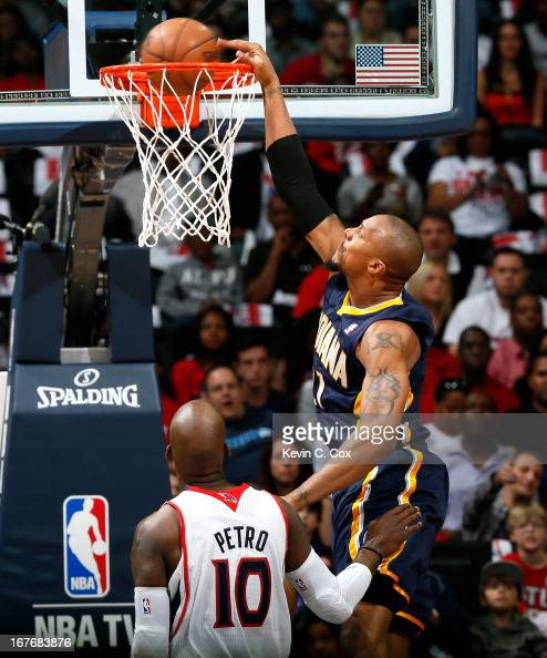 David West of the Indiana Pacers dunks against Johan Petro of the Atlanta Hawks during Game Three of the Eastern Conference Quarterfinals of the 2013...