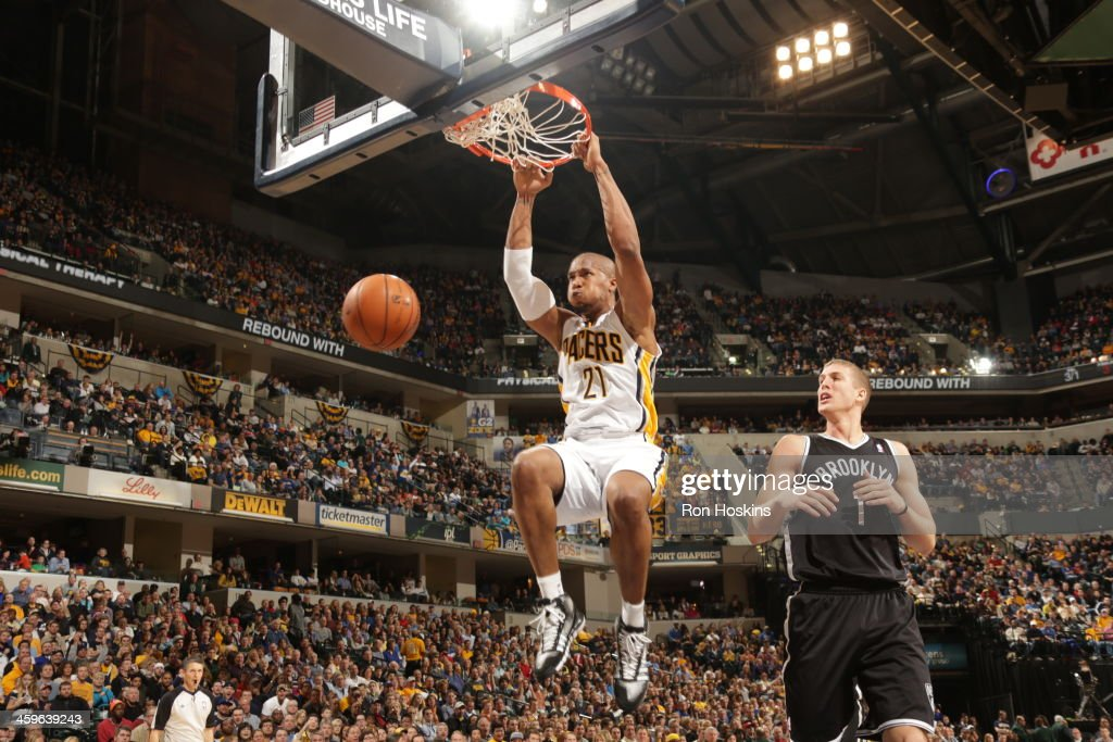 David West #21 of the Indiana Pacers dunks the ball against the Brooklyn Nets at Bankers Life Fieldhouse on December 28, 2013 in Indianapolis, Indiana.