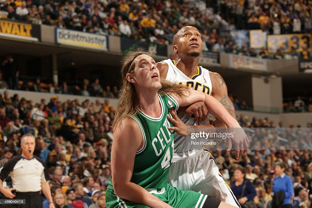 David West #21 of the Indiana Pacers fights for position against Kelly Olynyk #41 of the Boston Celtics on December 22, 2013 in Indianapolis, Indiana at Bankers Life Fieldhouse.