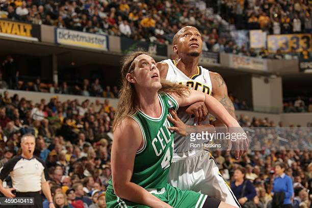 David West of the Indiana Pacers fights for position against Kelly Olynyk of the Boston Celtics on December 22 2013 in Indianapolis Indiana at...
