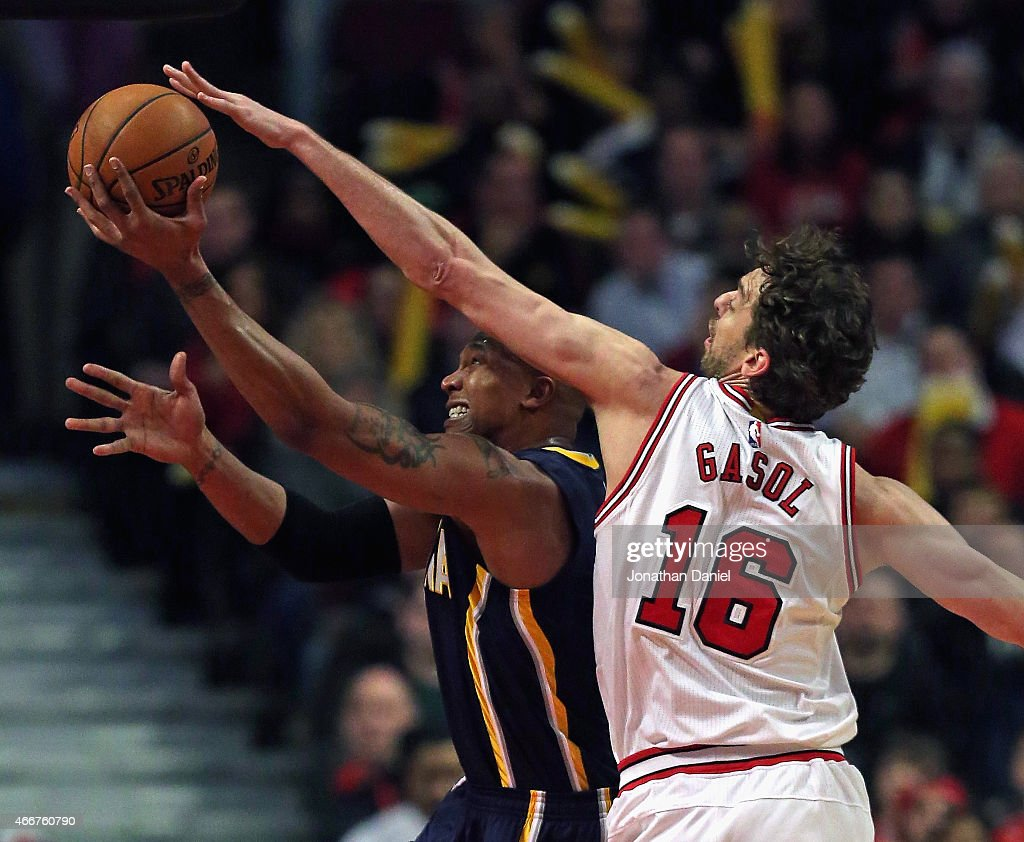 David West #21 of the Indiana Pacers gets off a shot under pressure from Pau Gasol #16 of the Chicago Bulls at the United Center on March 18, 2015 in Chicago, Illinois.