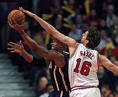 David West of the Indiana Pacers gets off a shot under pressure from Pau Gasol of the Chicago Bulls at the United Center on March 18 2015 in Chicago...