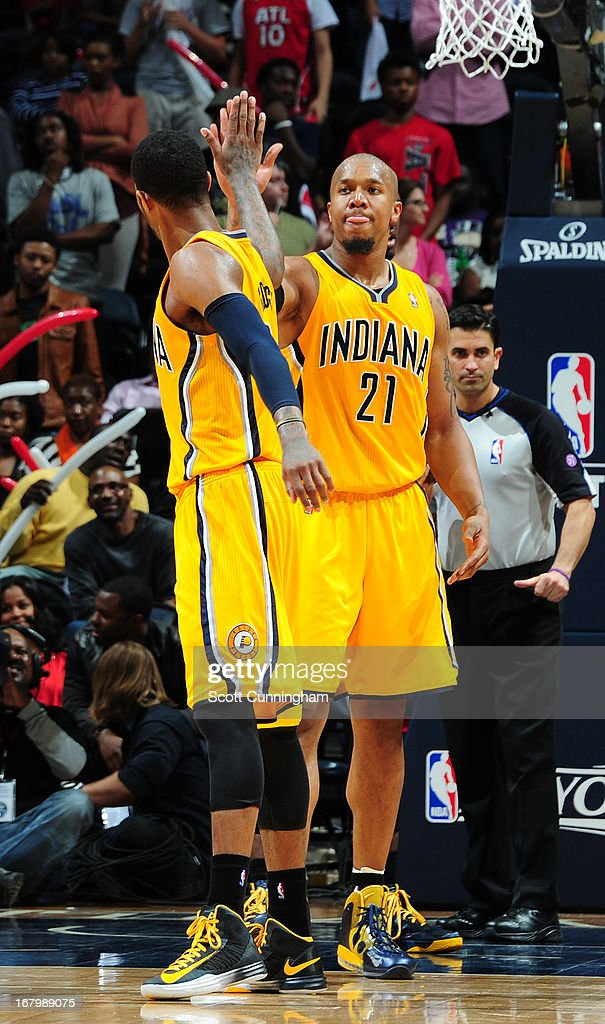 David West #21 of the Indiana Pacers gives a high five to a teammate against the Atlanta Hawks during Game Six of the Eastern Conference Quarterfinals in the 2013 NBA Playoffs on May 3, 2013 at Philips Arena in Atlanta, Georgia.