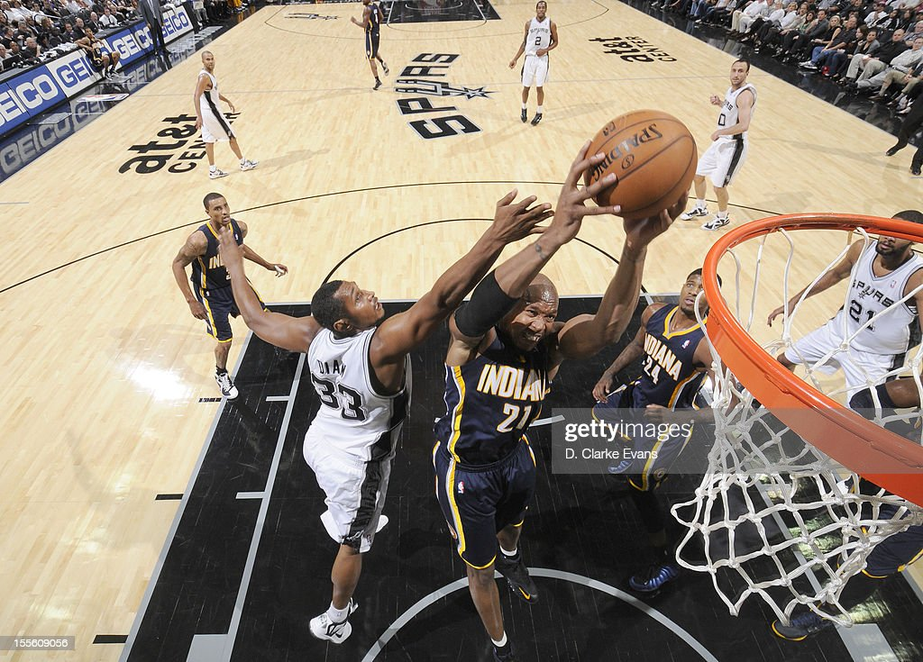 David West #21 of the Indiana Pacers goes to the basket against <a gi-track='captionPersonalityLinkClicked' href=/galleries/search?phrase=Boris+Diaw&family=editorial&specificpeople=201505 ng-click='$event.stopPropagation()'>Boris Diaw</a> #33 of the San Antonio Spurs during the game between the Indiana Pacers and the San Antonio Spurs on November 5, 2012 at the AT&T Center in San Antonio, Texas.