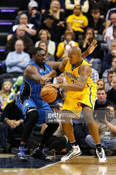 David West of the Indiana Pacers goes to the basket against Jason Maxiell of the Orlando Magic during the first half of the game at Bankers Life...
