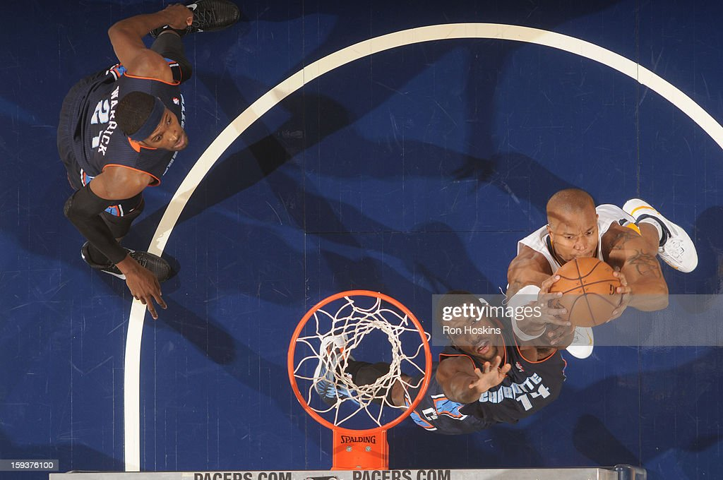 David West #21 of the Indiana Pacers goes to the basket against <a gi-track='captionPersonalityLinkClicked' href=/galleries/search?phrase=Michael+Kidd-Gilchrist&family=editorial&specificpeople=8526214 ng-click='$event.stopPropagation()'>Michael Kidd-Gilchrist</a> #14 of the Charlotte Bobcats during the game between the Indiana Pacers and the Charlotte Bobcats on January 12, 2013 at Bankers Life Fieldhouse in Indianapolis, Indiana.