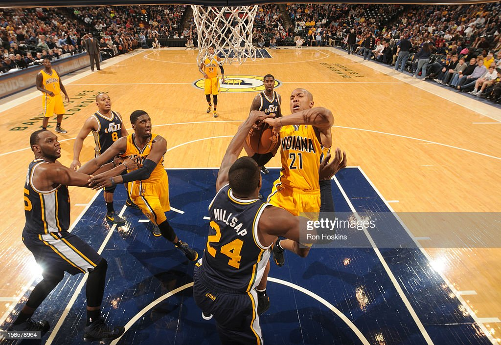 David West #21 of the Indiana Pacers goes to the basket against <a gi-track='captionPersonalityLinkClicked' href=/galleries/search?phrase=Paul+Millsap&family=editorial&specificpeople=880017 ng-click='$event.stopPropagation()'>Paul Millsap</a> #24 of the Utah Jazz during the game between the Indiana Pacers and the Utah Jazz on December 19, 2012 at Bankers Life Fieldhouse in Indianapolis, Indiana.