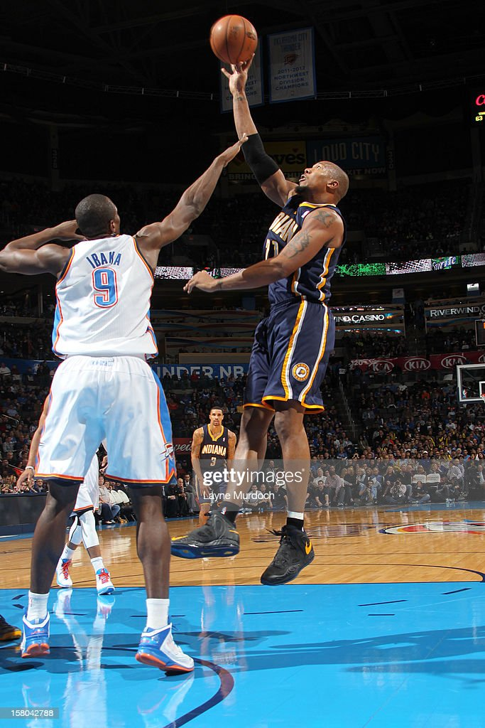 David West #21 of the Indiana Pacers goes to the basket against <a gi-track='captionPersonalityLinkClicked' href=/galleries/search?phrase=Serge+Ibaka&family=editorial&specificpeople=5133378 ng-click='$event.stopPropagation()'>Serge Ibaka</a> #9 of the Oklahoma City Thunder during the game between the Oklahoma City Thunder and the Indiana Pacers on December 9, 2012 at the Chesapeake Energy Arena in Oklahoma City, Oklahoma.