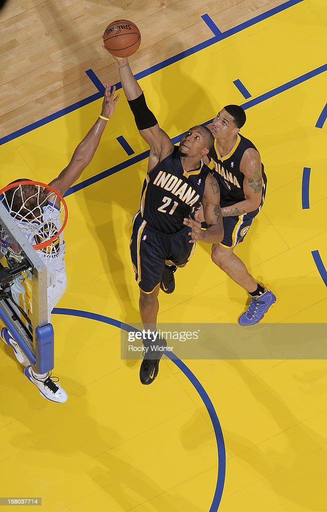 David West #21 of the Indiana Pacers goes up for the rebound against <a gi-track='captionPersonalityLinkClicked' href=/galleries/search?phrase=Carl+Landry&family=editorial&specificpeople=4111952 ng-click='$event.stopPropagation()'>Carl Landry</a> #7 of the Golden State Warriors on December 1, 2012 at Oracle Arena in Oakland, California.