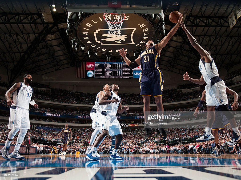 David West #21 of the Indiana Pacers grabs a rebound against the Dallas Mavericks on March 28, 2013 at the American Airlines Center in Dallas, Texas.