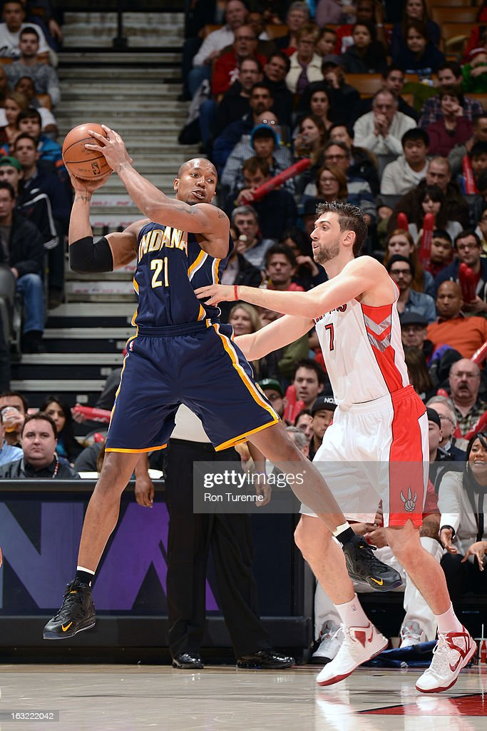 David West #21 of the Indiana Pacers grabs a rebound against the Toronto Raptors on March 1, 2013 at the Air Canada Centre in Toronto, Ontario, Canada.
