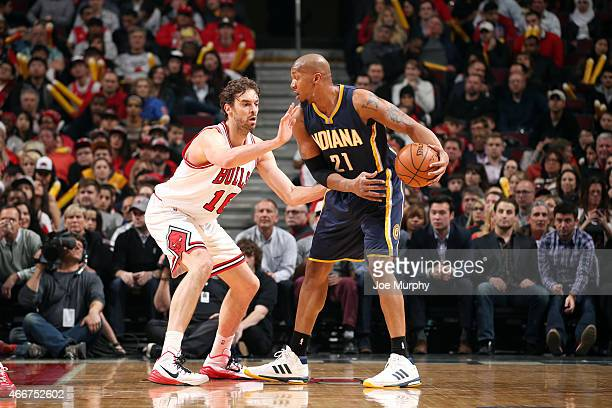 David West of the Indiana Pacers handles the ball against Pau Gasol of the Chicago Bulls on March 18 2015 at the United Center in Chicago Illinois...