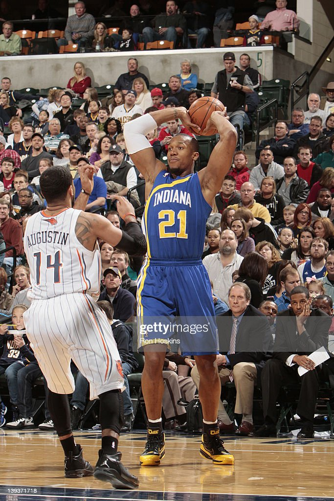 David West #21 of the Indiana Pacers looks to pass the ball against <a gi-track='captionPersonalityLinkClicked' href=/galleries/search?phrase=D.J.+Augustin&family=editorial&specificpeople=3847521 ng-click='$event.stopPropagation()'>D.J. Augustin</a> #14 of the Charlotte Bobcats on February 19, 2012 at Bankers Life Fieldhouse in Indianapolis, Indiana.