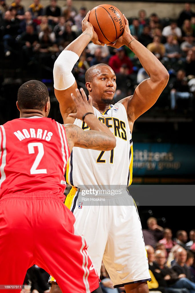 David West #21 of the Indiana Pacers looks to pass the ball against Marcus Morris #2 of the Houston Rockets on January 18, 2013 at Bankers Life Fieldhouse in Indianapolis, Indiana.