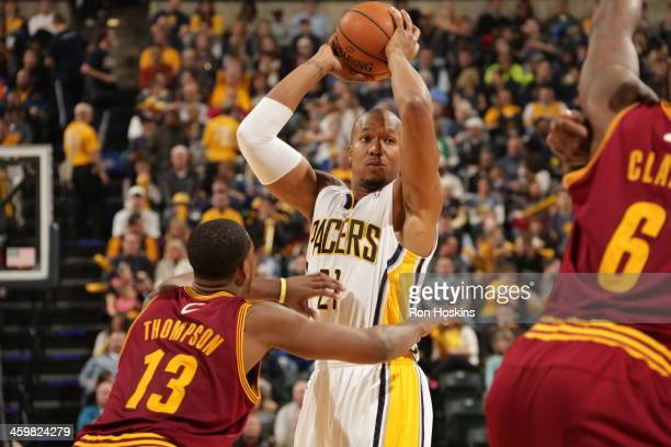 David West of the Indiana Pacers looks to pass the ball against the Cleveland Cavaliers at Bankers Life Fieldhouse on December 28 2013 in...