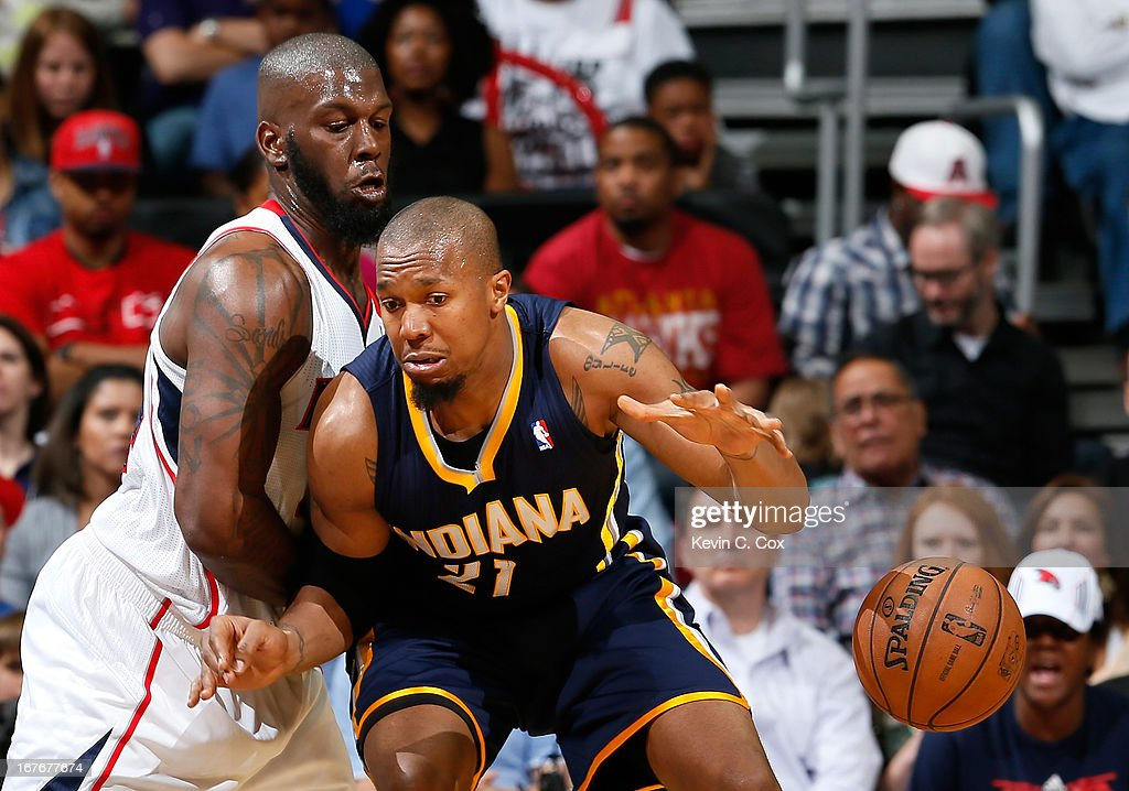 David West #21 of the Indiana Pacers loses the ball against Ivan Johnson #44 of the Atlanta Hawks during Game Three of the Eastern Conference Quarterfinals of the 2013 NBA Playoffs at Philips Arena on April 27, 2013 in Atlanta, Georgia.
