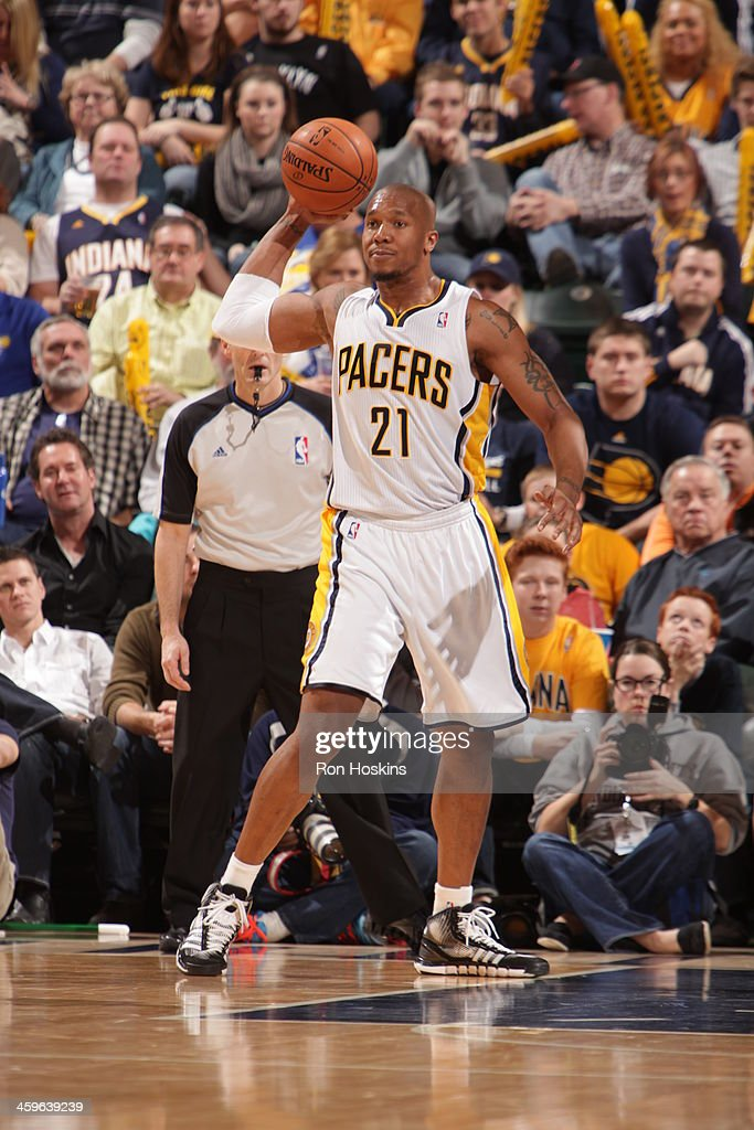 David West #21 of the Indiana Pacers passes the ball against the Brooklyn Nets at Bankers Life Fieldhouse on December 28, 2013 in Indianapolis, Indiana.