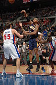 David West of the Indiana Pacers passes the ball against Viacheslav Kravtsov of the Detroit Pistons on February 23 2013 at The Palace of Auburn Hills...