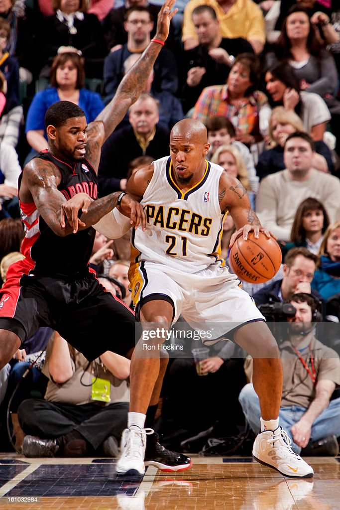 David West #21 of the Indiana Pacers posts up against Amir Johnson #15 of the Toronto Raptors on February 8, 2013 at Bankers Life Fieldhouse in Indianapolis, Indiana.