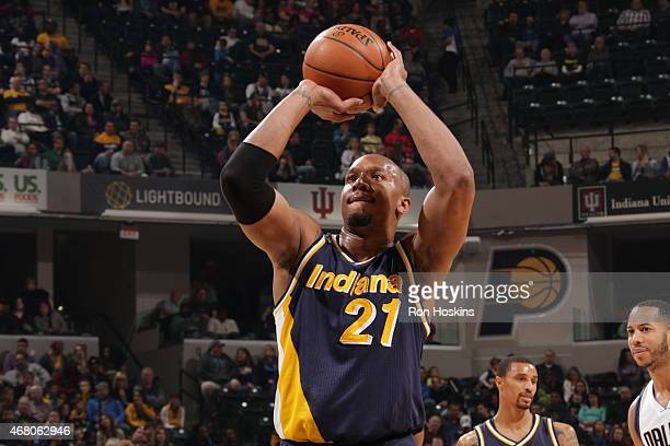 David West of the Indiana Pacers prepares to shoot a free throw against the Dallas Mavericks on March 29 2015 at Bankers Life Fieldhouse in...