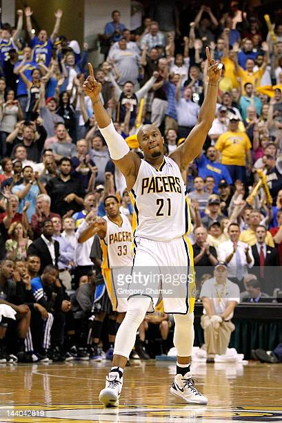 David West of the Indiana Pacers reacts to a three point basket late in the game by Danny Granger while playing the Orlando Magic in Game Five of the...