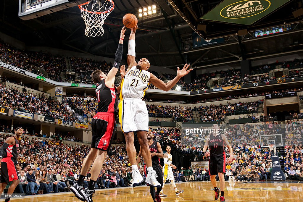 David West #21 of the Indiana Pacers rises for a dunk against <a gi-track='captionPersonalityLinkClicked' href=/galleries/search?phrase=Andrea+Bargnani&family=editorial&specificpeople=533014 ng-click='$event.stopPropagation()'>Andrea Bargnani</a> #7 of the Toronto Raptors on February 8, 2013 at Bankers Life Fieldhouse in Indianapolis, Indiana.