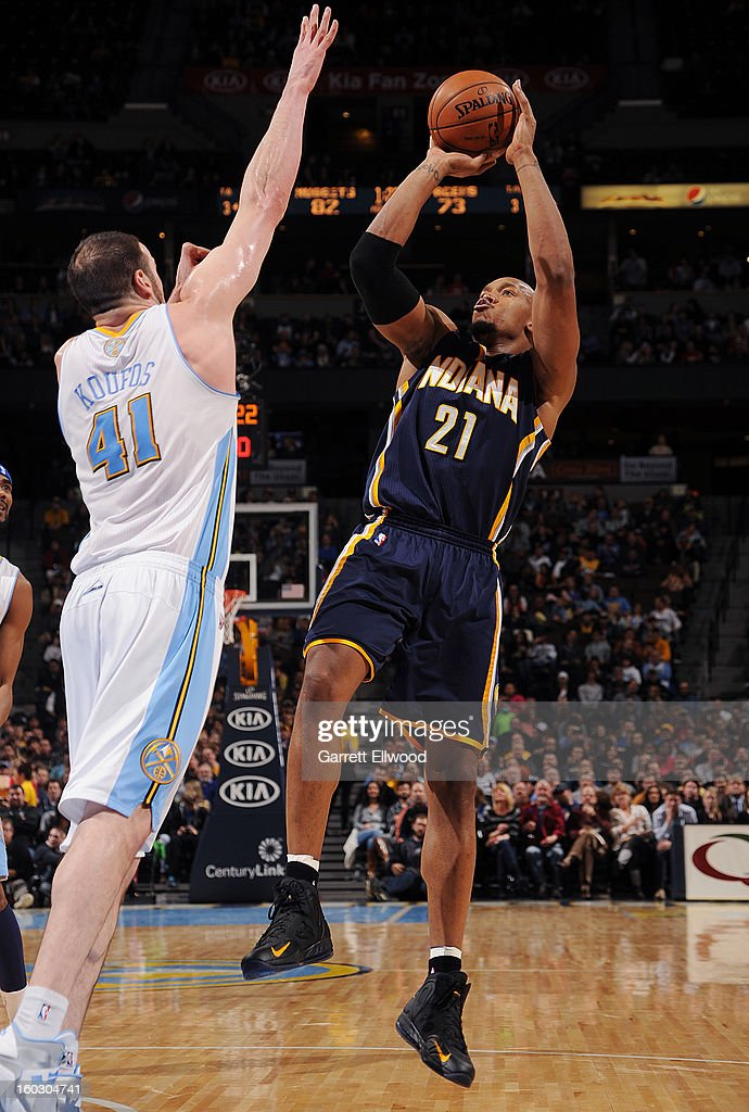 David West #21 of the Indiana Pacers shoots a fade away against Kosta Koufos #41 of the Denver Nuggets on January 28, 2013 at the Pepsi Center in Denver, Colorado.