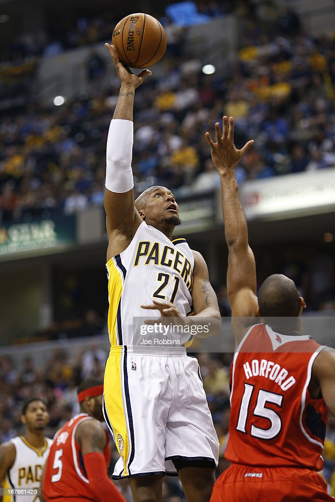 David West #21 of the Indiana Pacers shoots against Al Horford #15 of the Atlanta Hawks during the first quarter of Game Five of the Eastern Conference first round of the 2013 NBA Playoffs at Bankers Life Fieldhouse on May 1, 2013 in Indianapolis, Indiana.
