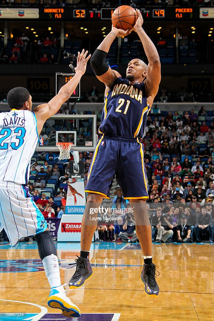 David West #21 of the Indiana Pacers shoots against Anthony Davis #23 of the New Orleans Hornets on December 22, 2012 at the New Orleans Arena in New Orleans, Louisiana.