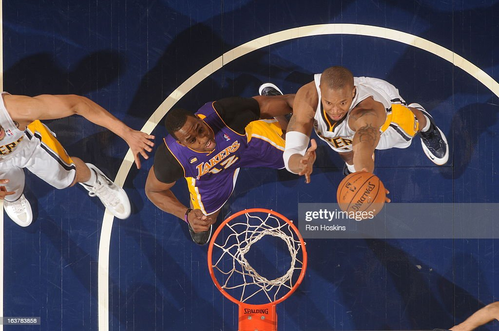 David West #21 of the Indiana Pacers shoots against <a gi-track='captionPersonalityLinkClicked' href=/galleries/search?phrase=Dwight+Howard&family=editorial&specificpeople=201570 ng-click='$event.stopPropagation()'>Dwight Howard</a> #12 of the Los Angeles Lakers on March 15, 2013 at Bankers Life Fieldhouse in Indianapolis, Indiana.