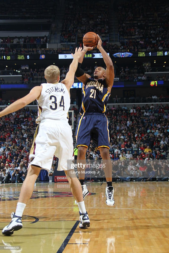 David West of the Indiana Pacers shoots against Greg Stiemsma of the New Orleans Pelicans on October 30 2013 at the New Orleans Arena in New Orleans...