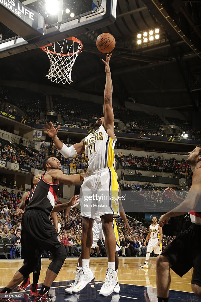 David West #21 of the Indiana Pacers shoots against <a gi-track='captionPersonalityLinkClicked' href=/galleries/search?phrase=Jared+Jeffries&family=editorial&specificpeople=202548 ng-click='$event.stopPropagation()'>Jared Jeffries</a> #1 of the Portland Trail Blazers on December 5, 2012 at Bankers Life Fieldhouse in Indianapolis, Indiana.