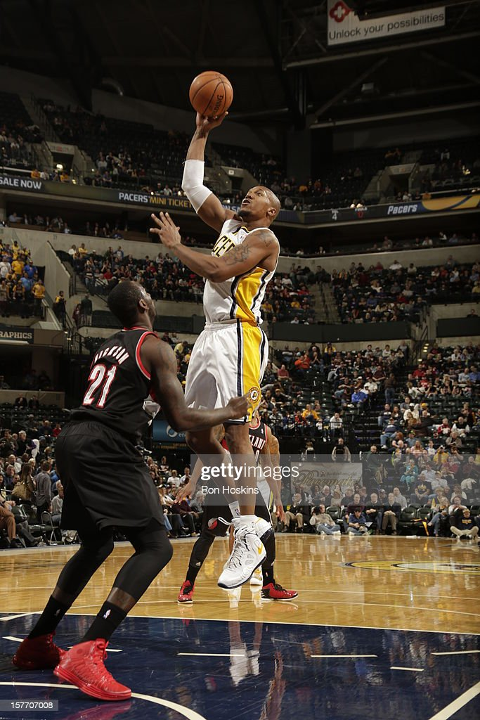 David West #21 of the Indiana Pacers shoots against <a gi-track='captionPersonalityLinkClicked' href=/galleries/search?phrase=J.J.+Hickson&family=editorial&specificpeople=4226173 ng-click='$event.stopPropagation()'>J.J. Hickson</a> #21 of the Portland Trail Blazers on December 5, 2012 at Bankers Life Fieldhouse in Indianapolis, Indiana.