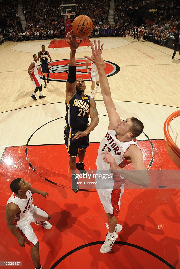 David West #21 of the Indiana Pacers shoots against <a gi-track='captionPersonalityLinkClicked' href=/galleries/search?phrase=Jonas+Valanciunas&family=editorial&specificpeople=5654195 ng-click='$event.stopPropagation()'>Jonas Valanciunas</a> #17 of the Toronto Raptors on October 31, 2012 at the Air Canada Centre in Toronto, Ontario, Canada.