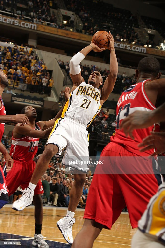 David West #21 of the Indiana Pacers shoots against <a gi-track='captionPersonalityLinkClicked' href=/galleries/search?phrase=Jordan+Crawford&family=editorial&specificpeople=4779380 ng-click='$event.stopPropagation()'>Jordan Crawford</a> #15 of the Washington Wizards on January 2, 2013 at Bankers Life Fieldhouse in Indianapolis, Indiana.
