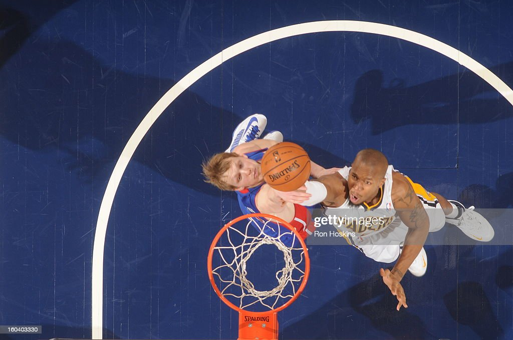 David West #21 of the Indiana Pacers shoots against <a gi-track='captionPersonalityLinkClicked' href=/galleries/search?phrase=Kyle+Singler&family=editorial&specificpeople=4216029 ng-click='$event.stopPropagation()'>Kyle Singler</a> #25 of the Detroit Pistons on January 30, 2013 at Bankers Life Fieldhouse in Indianapolis, Indiana.