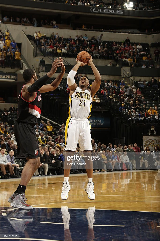 David West #21 of the Indiana Pacers shoots against <a gi-track='captionPersonalityLinkClicked' href=/galleries/search?phrase=LaMarcus+Aldridge&family=editorial&specificpeople=453277 ng-click='$event.stopPropagation()'>LaMarcus Aldridge</a> #12 of the Portland Trail Blazers on December 5, 2012 at Bankers Life Fieldhouse in Indianapolis, Indiana.