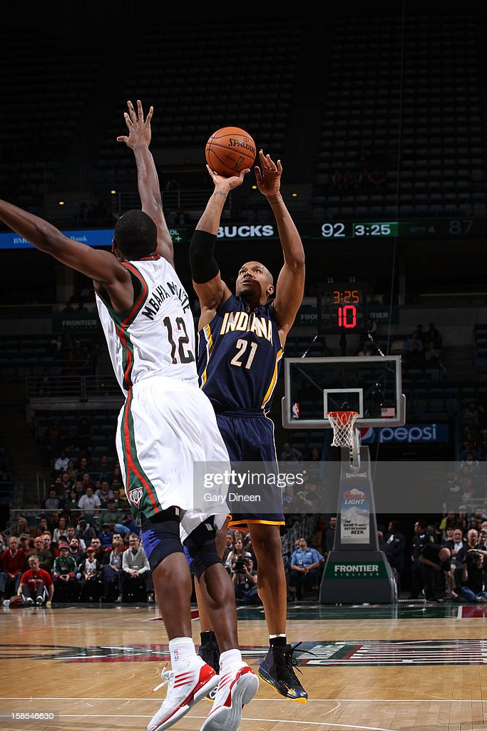 David West #21 of the Indiana Pacers shoots against <a gi-track='captionPersonalityLinkClicked' href=/galleries/search?phrase=Luc+Richard+Mbah+a+Moute&family=editorial&specificpeople=699041 ng-click='$event.stopPropagation()'>Luc Richard Mbah a Moute</a> #12 of the Milwaukee Bucks during the game on December 18, 2012 at the BMO Harris Bradley Center in Milwaukee, Wisconsin.