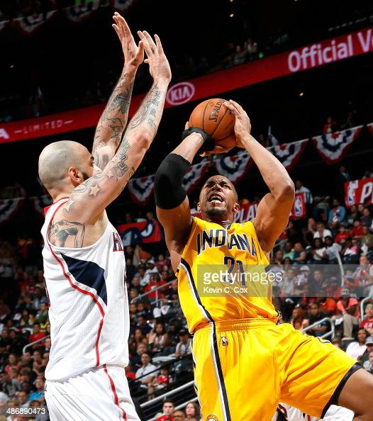 David West of the Indiana Pacers shoots against Pero Antic of the Atlanta Hawks in Game Four of the Eastern Conference Quarterfinals during the 2014...