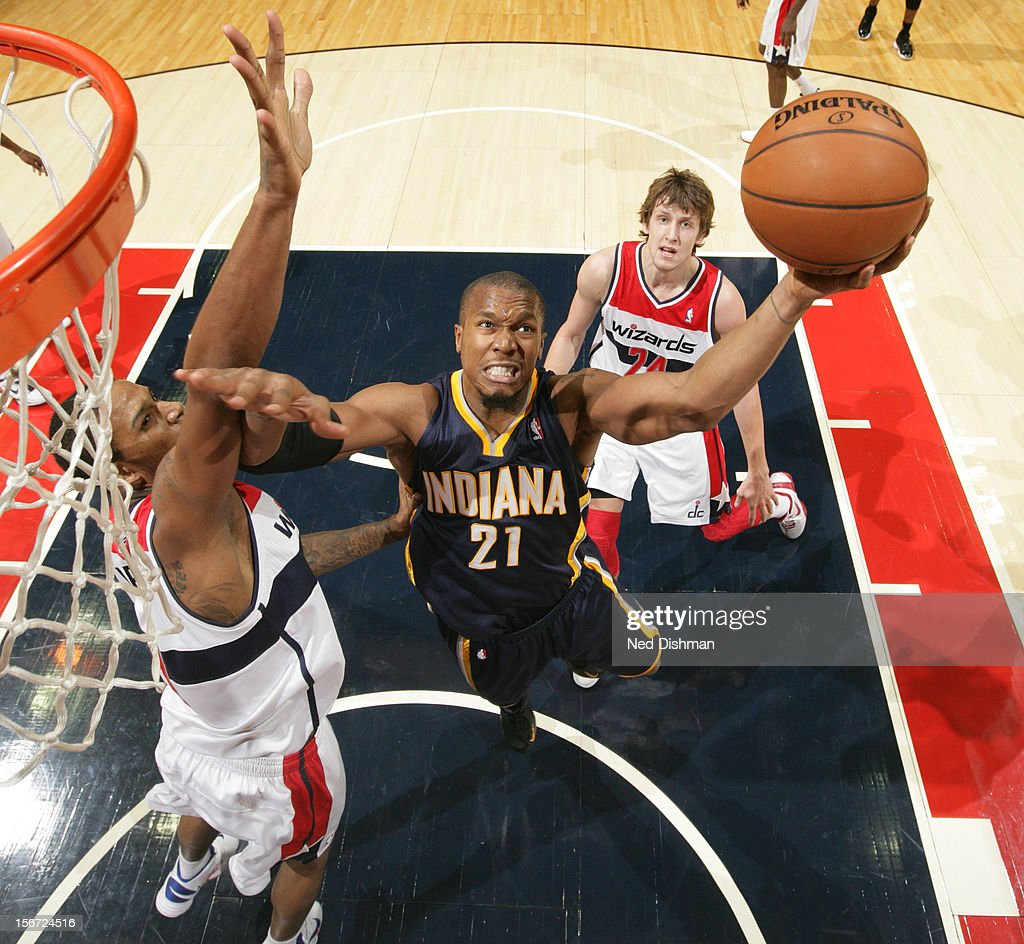David West #21 of the Indiana Pacers shoots against <a gi-track='captionPersonalityLinkClicked' href=/galleries/search?phrase=Trevor+Ariza&family=editorial&specificpeople=201708 ng-click='$event.stopPropagation()'>Trevor Ariza</a> #1 of the Washington Wizards during the game at the Verizon Center on November 19, 2012 in Washington, DC.