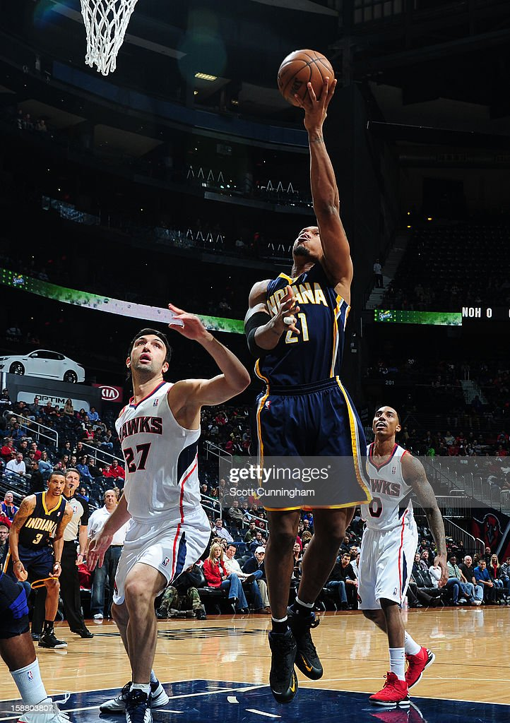 David West #21 of the Indiana Pacers shoots against <a gi-track='captionPersonalityLinkClicked' href=/galleries/search?phrase=Zaza+Pachulia&family=editorial&specificpeople=202939 ng-click='$event.stopPropagation()'>Zaza Pachulia</a> #27 of the Atlanta Hawks on December 29, 2012 at Philips Arena in Atlanta, Georgia.