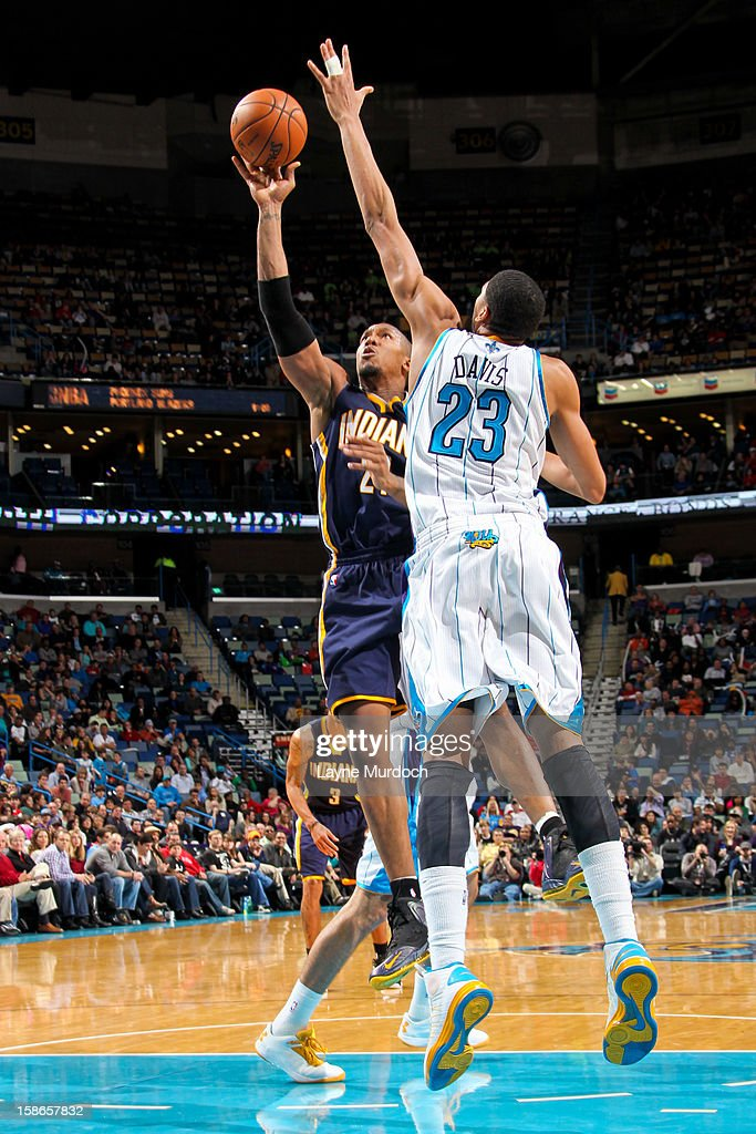 David West #21 of the Indiana Pacers shoots in the lane against Anthony Davis #23 of the New Orleans Hornets on December 22, 2012 at the New Orleans Arena in New Orleans, Louisiana.