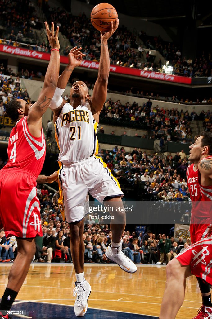 David West #21 of the Indiana Pacers shoots in the lane against Greg Smith #4 of the Houston Rockets on January 18, 2013 at Bankers Life Fieldhouse in Indianapolis, Indiana.